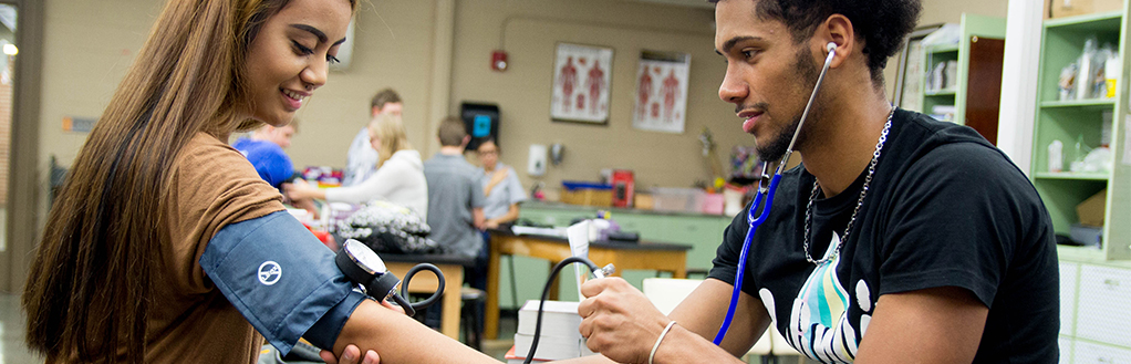 Students Using Blood Pressure Cuff